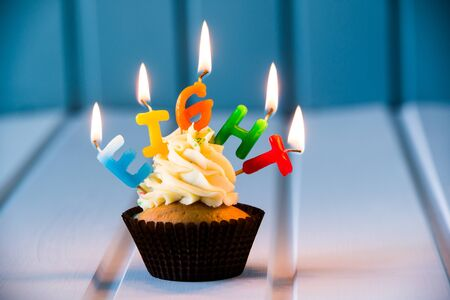 Birthdays cake - cupcake with a candles for 8 - eighth birthday . Happy birthday ! Stock Photo