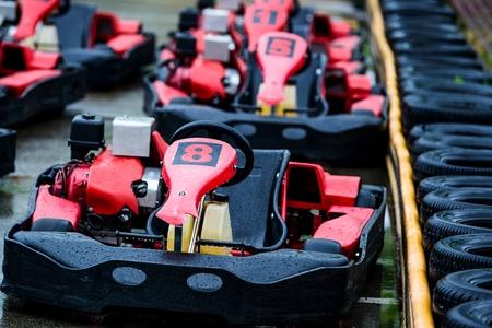 Red racing gokarts on track. Rainy day