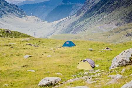 balea: Touristic tents near Balea Lake in Romanian Carpathian at summer Stock Photo