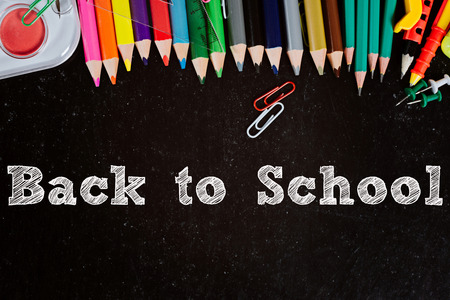 Back to school. Blackboard with school accessories