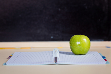 Back to school. School notepad with apple