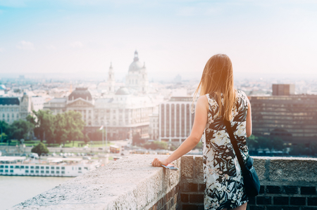business traveller: Young woman looking on city - Budapest from viewpoint Stock Photo