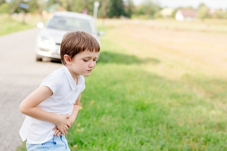 Seven years old child feeling bad - suffers from motion sickness Stock Photo