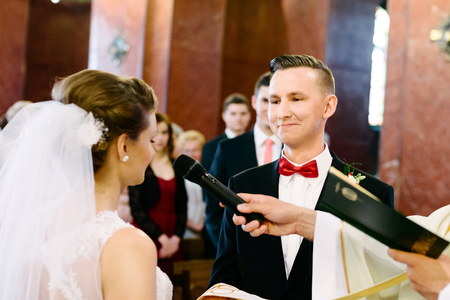 vow: Wedding ceremony in catholic church. Marriage vow. Wedding day