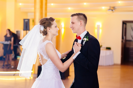 first day: Newlyweds first dance on wedding party. Wedding day. Stock Photo