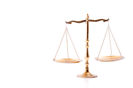 lawfulness: Golden scales of justice. Isolated on white background Stock Photo