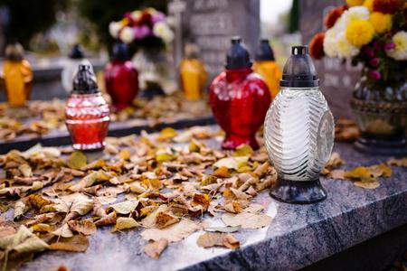 all saints day: Grave at autumn. November 1, All Saints Day