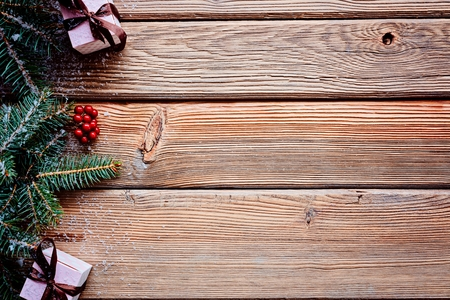 Wooden christmas background with small christmas gifts above