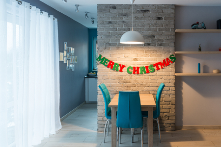 modern dining room: Modern dining room with grey brick wall and Christmas decoration