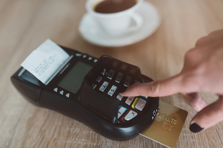 pin code: Consument entering pin code on card terminal during payment Stock Photo