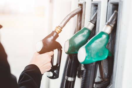 fueling pump: Woman holding diesel fuel nozzle at the gas station