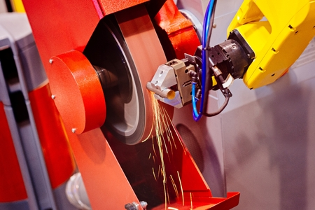 sharpening process: Automatic grinding machine in the factory grinds a piece of metal with sparks