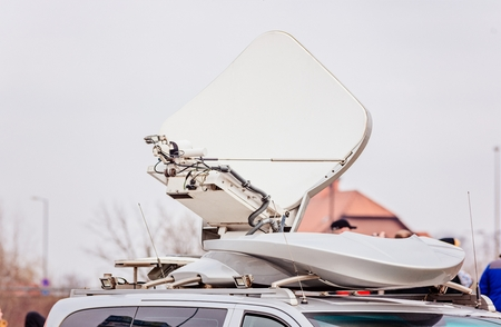 Satellite dish antenna mounted on television broadcasting van