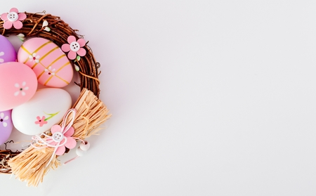 Easter eggs in nest on white background with space for message. Happy Easter
