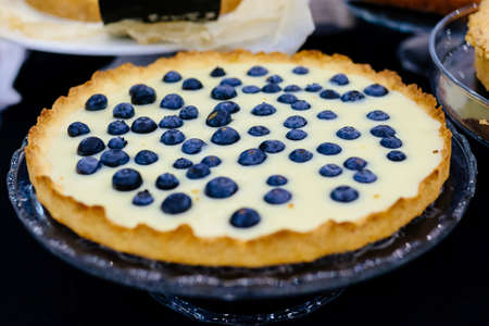 Delicious sweet bilberry vanilla tart cake on the tray Stock Photo