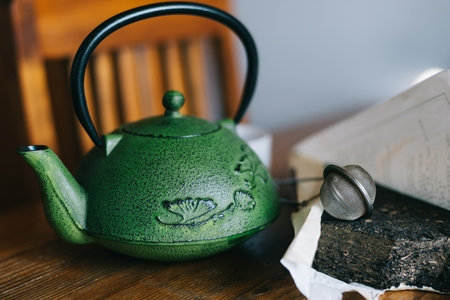 oxidate: Asian Chinese pressed pu-erh tea with green teapot and infuser