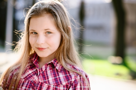 portrait of happy blond hair ten years old blue eyed girl stock