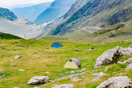 Touristic tents near Transfagarasan mountain road in Romania - one of most famous roads in Europe