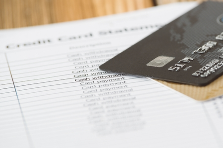 plastic credit cards on monthly credit card statement information stock photo 80696044 - Plastic Credit Card