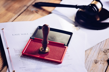 Metal notary public ink stamper. Law office. Stock Photo