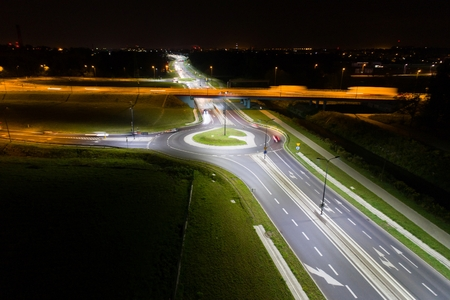 Crossroads and roundabout at night. Aerial view. Poland, Silesia, Gliwice