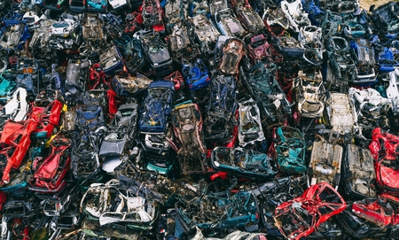 Destroyed scrapped cars stacked on a scrap yard. Car recycling Archivio Fotografico