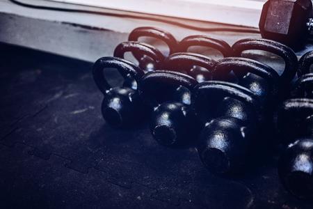 Metal heavy kettlebells weights in the gym. Crossfit workout of the day.