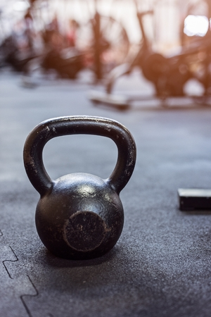 Heavy metal kettlebells weights in the gym. Stock Photo