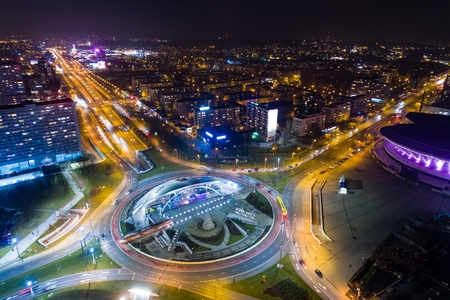 Aerial drone view of roundabout in Katowice at night. Silesia, Poland Foto de archivo