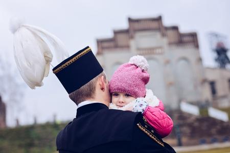 Black coal foreman miner in gala uniform with his child. Polish miner. Katowice, Silesia, Poland Zdjęcie Seryjne