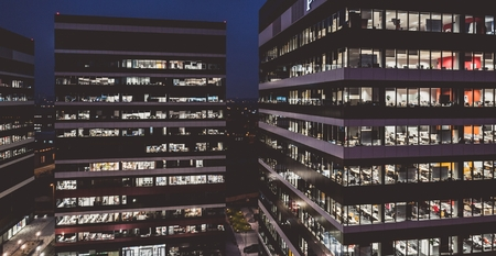 Corporation office buildings at night. Late working