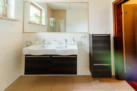 Modern bathroom with double washbasin and mirror