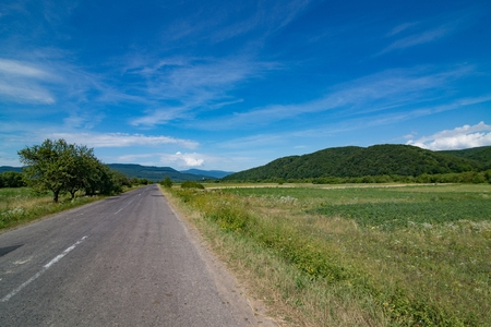 Ukrainian country road at summer. Carpathian Mountains in Ukraine