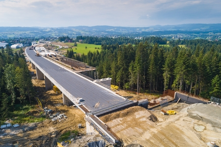 Aerial drone view on road under construction. Construction of the viaduct on the national road number 7 in Poland
