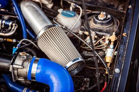 Sport air filter in a gasoline turbocharged car engine. Car tuning