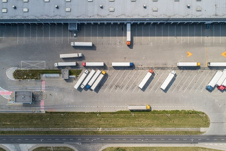 Aerial drone view on warehouse and logistic center. Logistic and transport concept Standard-Bild