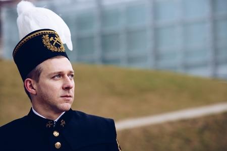 Black coal miner foreman in gala parade uniform, Silesia, Poland