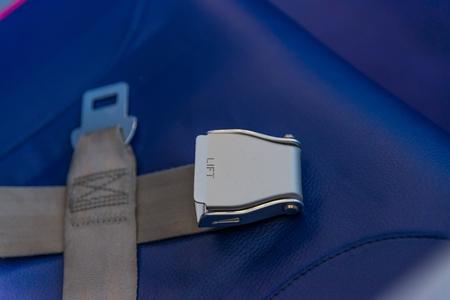 Safety seat belt in passenger airplane. Passenger plane interior