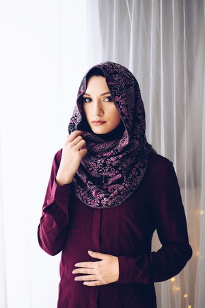 Portrait of young beautiful arabic middle eastern woman wearing hijab Stock Photo