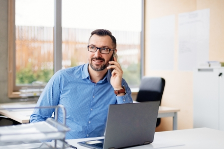 40 years old middle aged handsome man working on laptop computer in office. Man working in office Standard-Bild - 116596238