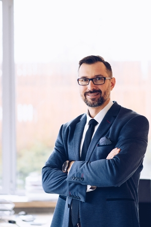 40 years old handsome businessman in suit at office. Man working in office Standard-Bild - 116597413