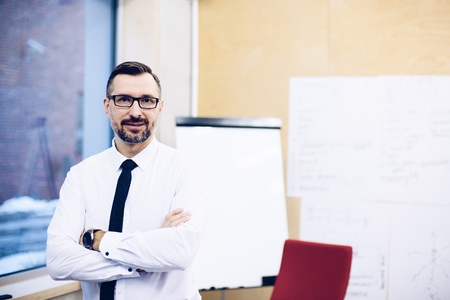 Middle aged handsome manager businessman in white shirt at office. Man working in office Standard-Bild - 116596285