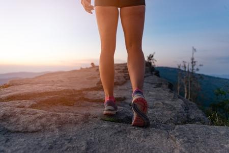 Woman cross country runner legs in mountains at summer. Woman running. Silesian Beskid, Szczyrk Standard-Bild - 116597525