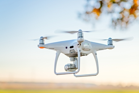 Professional drone with camera in flight. White drone quadrocopter. Unmanned aerial vehicle Standard-Bild - 116596334