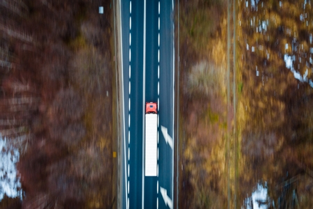 Aerial drone view on TIR truck on asphalt road. Transport and logistic concept Archivio Fotografico