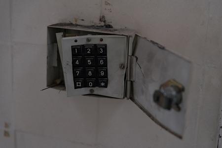 Broken home alarm system with destroyed keypad.