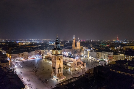 Aerial drone view Cracow old town and city main square at night. Cracow, Lesser Poland