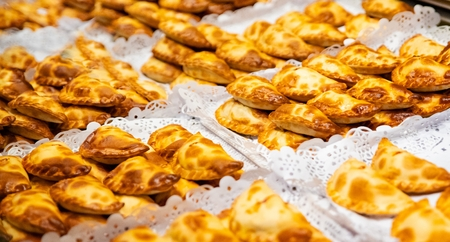 Traditional Spanish dumpling empanadas. Empanada is a type of baked or fried pasty, consisting of pastry and filling