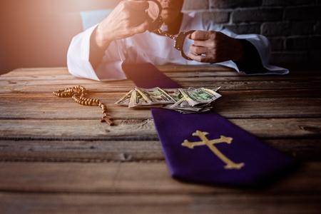 Banknotes and catholic church symbols. Church and money Banco de Imagens