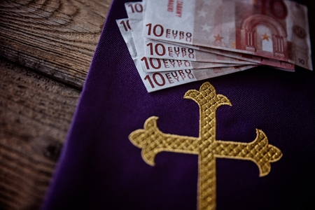 Catholic church symbols and Euro banknotes. Church and money